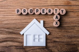 is it better to pay property tax with a mortgage